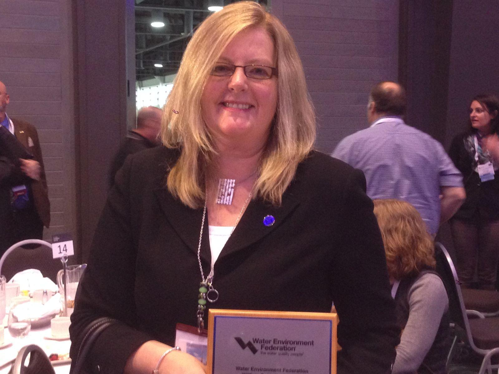 Bev Mollard Poses with the Hatfield Award